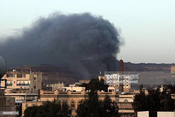 Smoke billows from buildings in Fajj Attan a neighbourhood overlooking the capital Sanaa following a reported airstrike by the Saudiled coalition on...