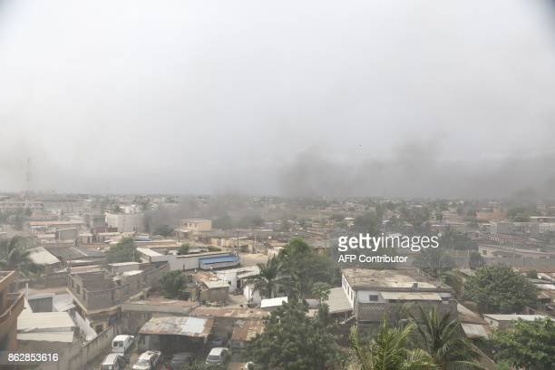 Smoke billows from burning barricades in Lome on October 18 2017 where opposition supporters erected makeshift barricades and blocked roads as...
