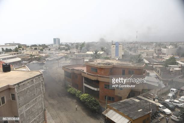 TOPSHOT Smoke billows from burning barricades in Lome on October 18 2017 where opposition supporters erected makeshift barricades and blocked roads...