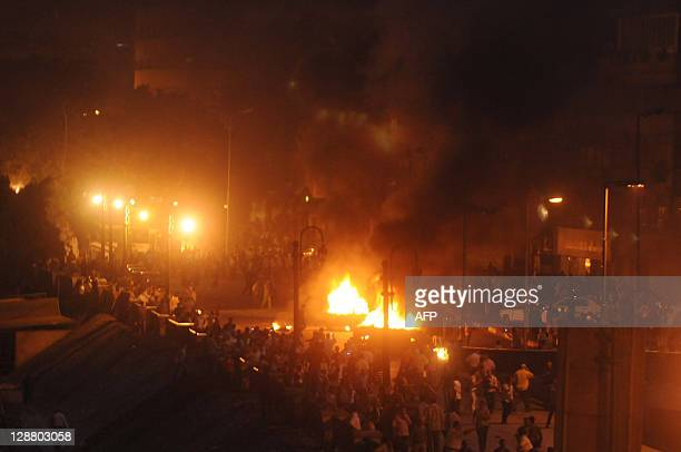 Smoke billows from burning cars as clashes erupted between Egyptian Coptic Christians and security forces in Cairo during a protest against the...