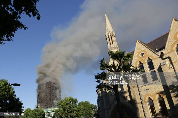 Smoke billows from Grenfell Tower after a fire engulfed the block on June 14 2017 in west London The massive fire ripped through the 27storey...