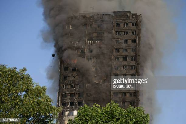TOPSHOT Smoke billows from Grenfell Tower as firefighters attempt to control a huge blaze on June 14 2017 in west London The massive fire ripped...