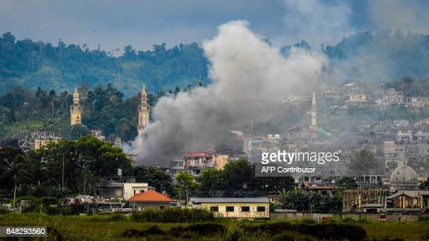 Smoke billows from houses after aerial bombings by Philippine Airforce planes on Islamist militant positions in Marawi on the southern island of...