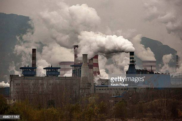 Smoke billows from smokestacks at a steel factory on November 19 2015 in the industrial province of Hebei China China's government has set 2030 as a...