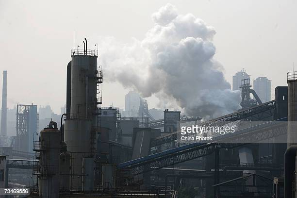 Smoke billows from steel slags at a plant of Chongqing Iron and Steel Co Ltd on March 1 2007 in Chongqing Municipality China Chongqing Steel will...
