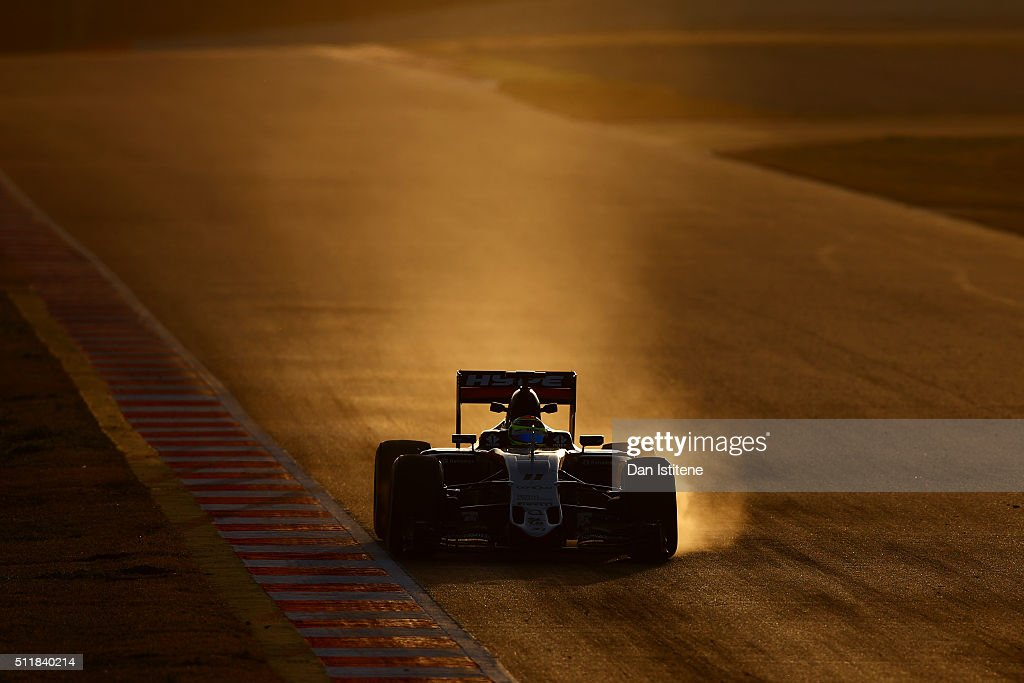 Smoke billows from the brakes of Sergio Perez of Mexico and Force India's car as he drives during day two of F1 winter testing at Circuit de Catalunya on February 23, 2016 in Montmelo, Spain.