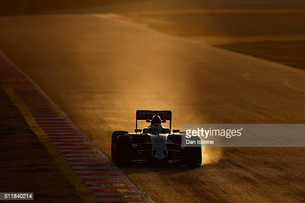 Smoke billows from the brakes of Sergio Perez of Mexico and Force India's car as he drives during day two of F1 winter testing at Circuit de...