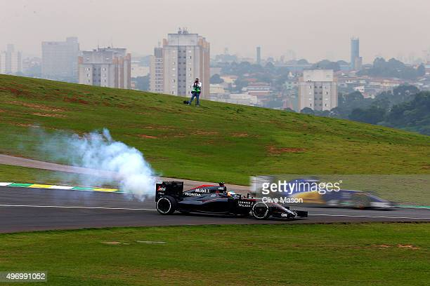 Smoke billows from the car of Fernando Alonso of Spain and McLaren Honda as he stops on the track during practice for the Formula One Grand Prix of...