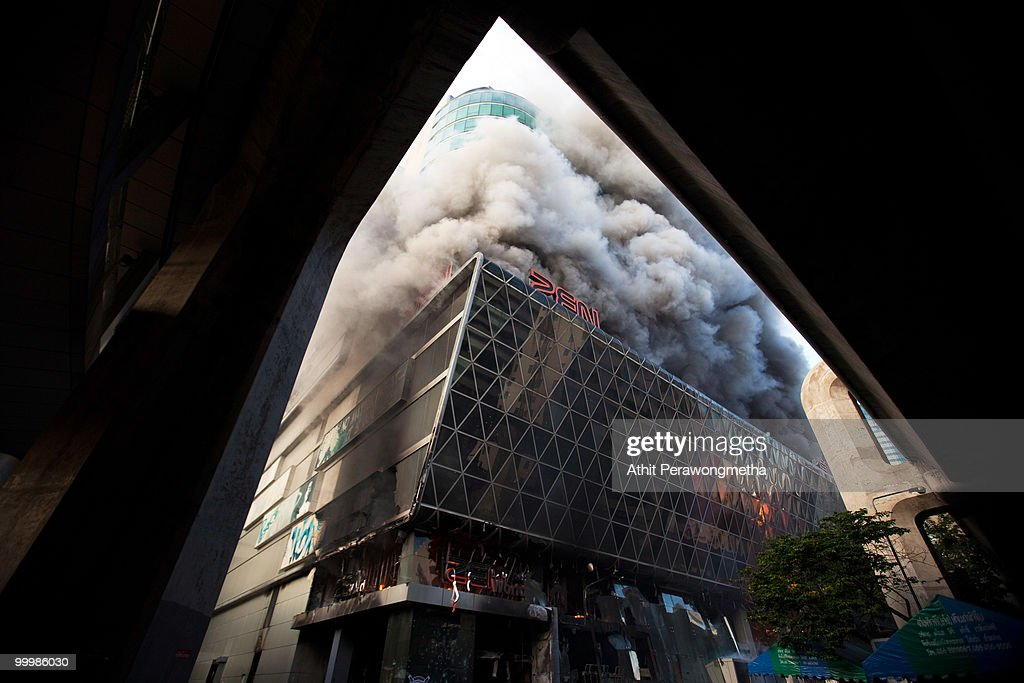 Smoke billows from the Central World Shopping Center, which was set alight by Red Shirt protesters on May 19, 2010 in Bangkok, Thailand. At least 5 people are reported to have died as government forces attempted to overrun barricades raised in and around the city centre by anti-government protestors. Red-shirt leaders have now surrendered, ending their blockade following a sixth day of violence, leaving the army in control and a night time curfew to be imposed