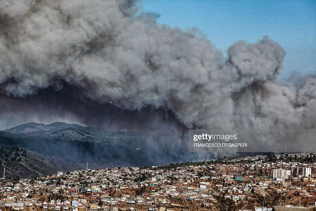 Smoke billows from the forest around Valparaiso in Chile on March 13 2015 as the fire threatens to reach the city's port Authorities have declared a...