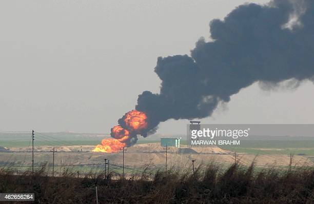 Smoke billows from the Khubbaz oil field some 25 km west of the northern Iraqi city of Kirkuk on February 2 a fews days after Peshmerga forces and...