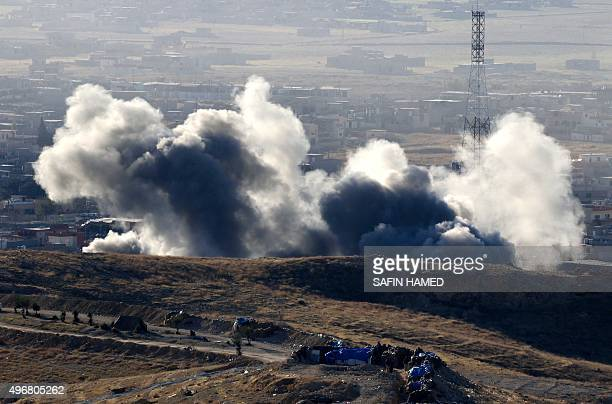 Smoke billows from the northern Iraqi town of Sinjar during an operation by Iraqi Kurdish forces backed by USled strikes on November 12 to retake the...