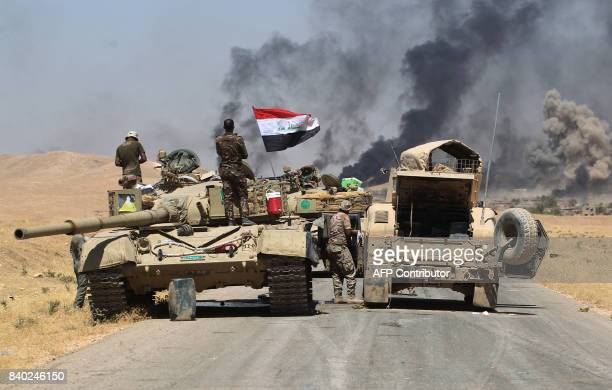 Smoke billows from the village of alAyadieh near Qubuq north of Tal Afar as Iraqi forces advance during the ongoing operation to retake the area from...