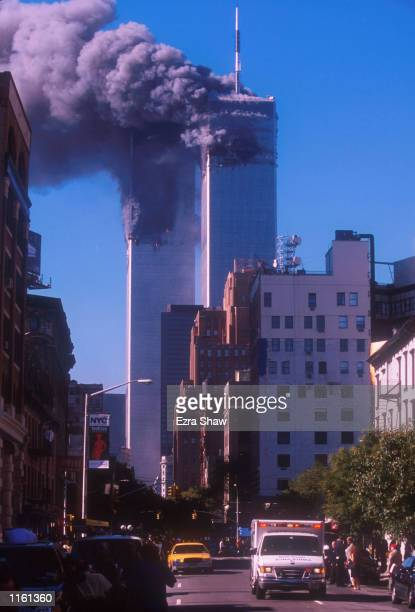 Smoke billows from the World Trade Center's twin towers after they were struck by commerical airliners in a suspected terrorist attack September 11...