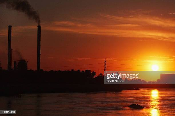 Smoke billows from thermal unit 3 at the Daura Power Station March 14 2004 in Baghdad Iraq Nearly a year after the USled war against Iraq the Daura...