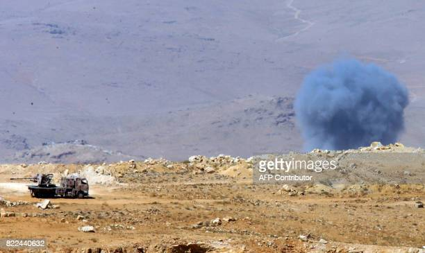 TOPSHOT Smoke billows in a mountainous area around the Lebanese border town of Arsal on July 25 2017 as seen during a press tour organised by...