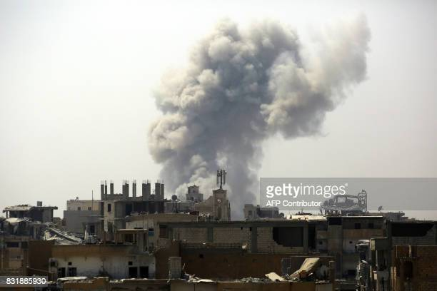 Smoke billows in an eastern area of the embattled northern Syrian city of Raqa on August 15 as Syrian Democratic Forces a US backed KurdishArab...