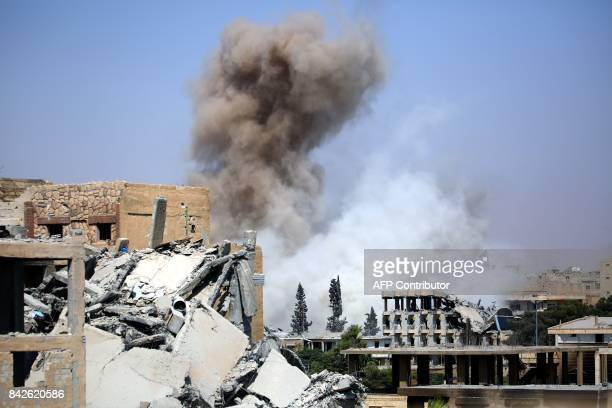 Smoke billows in Raqa on September 4 as Syrian Democratic Forces a US backed KurdishArab alliance battle to retake the northern Syrian city from the...