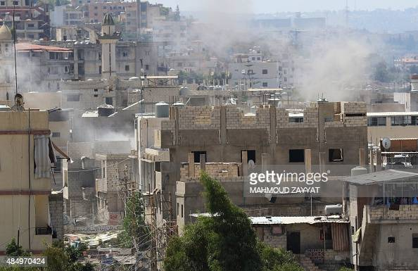 Smoke billows in the Ain ElHelweh Palestinian refugee camp near Lebanon's southern port city of Sidon on August 23 2015 a day after two people were...