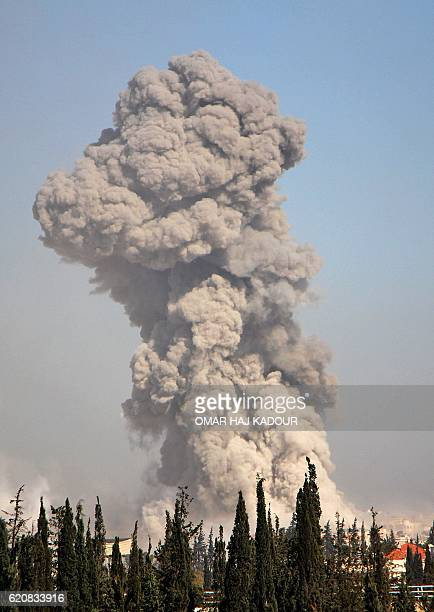 Smoke billows in the background on November 3 at an entrance to Aleppo in the southwestern frontline near the neighbourhood of Dahiyet alAssad during...