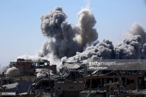 TOPSHOT Smoke billows in the embattled northern Syrian city of Raqa on September 3 as Syrian Democratic Forces a US backed KurdishArab alliance...