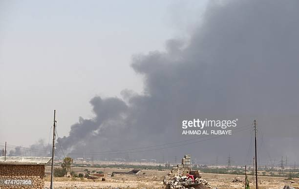 Smoke billows in the outskirts of Baiji refinery north of Tikrit in the Salahaddin province as the Iraqi army and Shiite popular mobilisation unit...