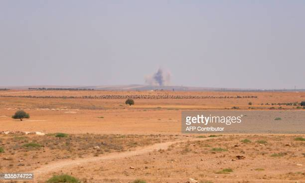 Smoke billows in the Salamiyah city some 33 kilometres southeast of Hama on August 19 during an offensive by Syrian progovernment forces against...