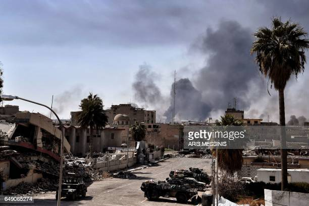 TOPSHOT Smoke billows in west Mosul as Iraqi troops battle against Islamic State group fighters to further advance inside the city on March 7 2017...