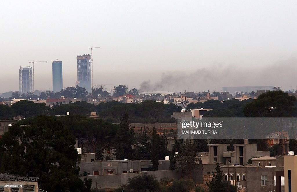Smoke billows on November 25 2014 from the Mitiga airport in an eastern suburb of the Libyan capital Tripoli held by antigovernment militias after an...