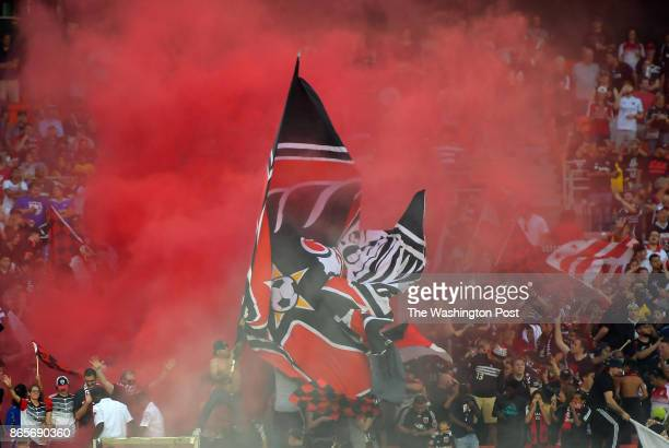 A smoke bomb goes off in the District Ultras section during New York Red Bulls defeat of the DC United 21 in the final game to be played at RFK...