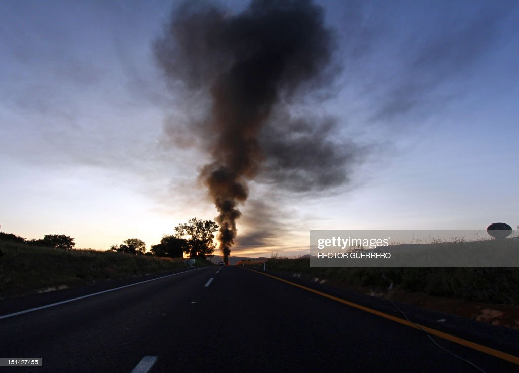 Smoke caused by a gas pipeline explosion in Zapotlanejo, 30 km from Guadalajara city, Jalisco State, Mexico on October19, 2012. A leaking gas pipeline exploded in western Mexico, forcing the evacuation of 2,000 people, and injuring at least three, as crews battled Friday to put out the blaze. The fire broke out Thursday evening in the town of Zapotlanejo near a highway and forced authorities to close the road, said Trinidad Lopez Rivas, head of the emergency services department in Jalisco state. AFP PHOTO/Hector Guerrero