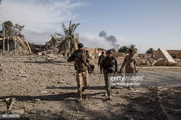 Smoke column rises form a close astride on advancing ISIS forces Soldiers collecting spoils from the battle while scouting the Anbar Operations...
