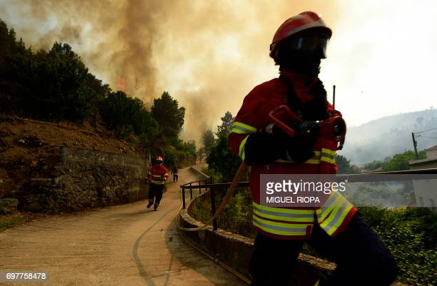 Smoke columns raise as firefighters work to extinguish a wildfire in Carvalho next to Pampilhosa da Serra on June 19 2017 More than 1000 firefighters...