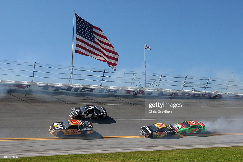 Smoke comes from the car of Danica Patrick, driver of the #10 GoDaddy.com Chevrolet, during the NASCAR Sprint Cup Series Aaron's 499 at Talladega Superspeedway on May 4, 2014 in Talladega, Alabama.