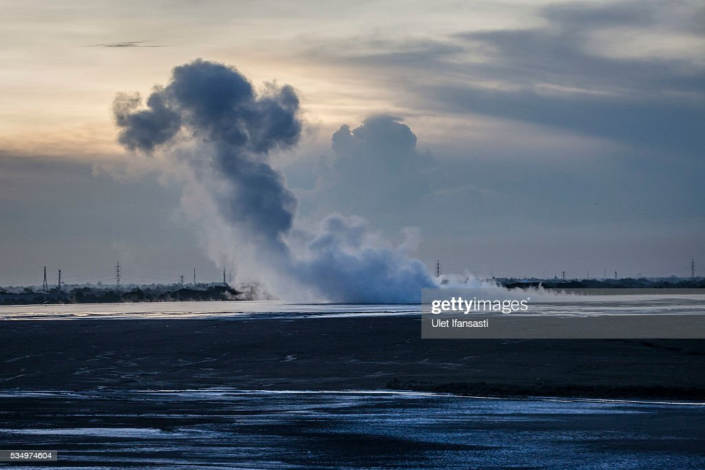 Smoke comes out from the mudflow on May 27, 2016 in Sidoarjo, East Java, Indonesia. Residents of villages that were damaged by the Sidoarjo mudflow and residents received compensation, after almost ten years, from the Indonesian oil and gas company, PT Lapindo Brantas. The mudflow eruption is suspected to have been triggered by the drilling activities of oil and gas company, though they refute the claims, instead blaming a 6.3 magnitude earthquake that struck a neighboring city two days before the mudflow eruption. The earthquake struck Yogyakarta on May 27th, 2006, a city 150 miles west of a drill site in Sidoarjo, two days before the mudflow eruption. According to reports, twenty lives were lost and nearly 40,000 people displaced, with damages topping $2.7 billion. Ten years since the eruption, the mud geysers continue to spurt daily and high levels of heavy metals have been detected in nearby rivers.