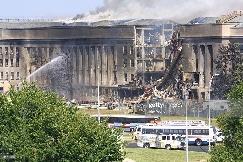 Smoke comes out from the Southwest Ering of the Pentagon building September 11 2001 in Arlington Va after a plane crashed into the building and set...