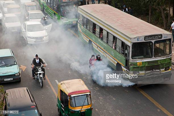 Smoke comes out of a public bus waiting at a traffic light in New Delhi India on Saturday Nov 26 2011 Morgan Stanley reduced its growth estimate for...