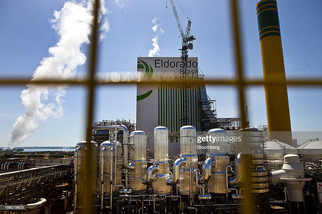Smoke comes out of the pulp mills at the Eldorado Celulose e Papel S.A processing plant in Tres Lagoas, Brazil, on Wednesday, Dec. 12, 2012. Eldorado Celulose e Papel S.A is finishing construction on a pulp processing plant that is expected to be one of the the world's largest single-line pulp plants when it reaches peak production. Photographer: Dado Galdieri/Bloomberg via Getty Images