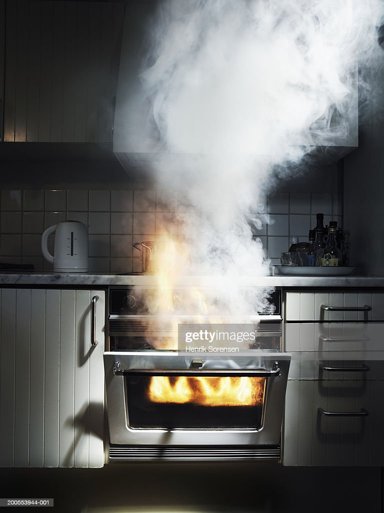 Smoke coming out from oven : Stock Photo