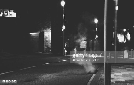 Smoke Coming Out From Sewage On Road At Night