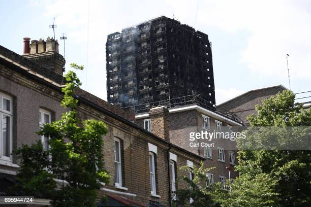 Smoke continues to rise from the 24 storey residential Grenfell Tower block in Latimer Road West London on June 14 2017 in London England The Mayor...