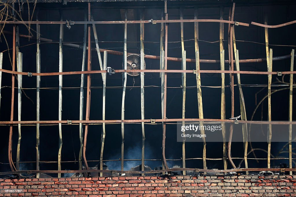 Smoke continues to rise from the site of a fire at a supermarket on February 17, 2013 in Changzhi, China. The supermarket caught fire at 4:10 a.m. today and was put out two hours later without any reports of casualties.