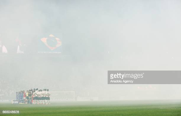 Smoke covers players during the national anthems singing ceremony before the Copa Sudamericana match between Corinthians and Universidad Chile at the...