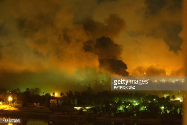 Smoke covers the presidential palace compound in Baghdad 21 March 2003 during a massive USled air raid on the Iraqi capital Smoke billowed from a...