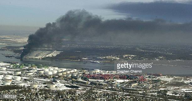Smoke drifts from an explosion at an oil storage refinery February 21 2003 in the Staten Island borough of New York Initial reports say that the...