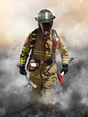 A firefighter pierces through a wall of smoke searching for survivors.