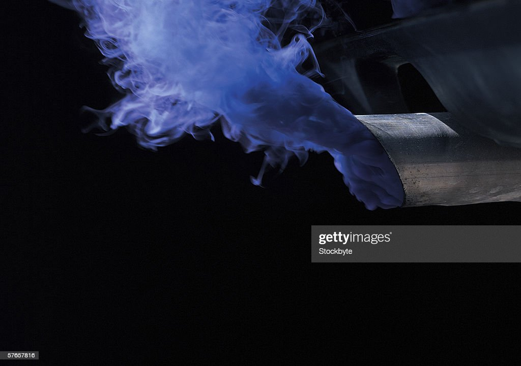 Smoke emissions from the exhaust pipe of a road vehicle
