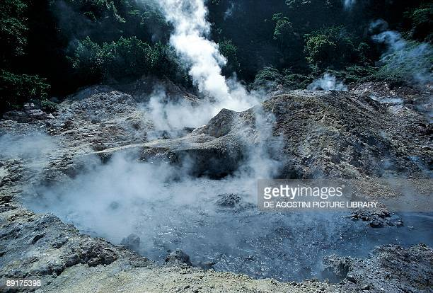 Smoke emitting from a volcanic landscape Solfatara Crater Antilles St Lucia