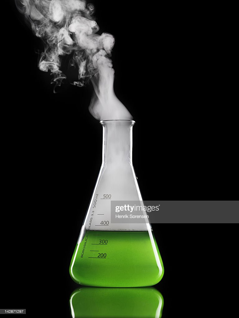 smoke emitting from laboratory flask : Stock Photo