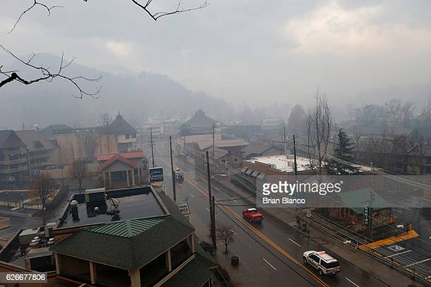 Smoke fills the air and surrounds businesses and resorts in the wake of a wildfire November 30 2016 in downtown Gatlinburg Tennessee Thousands of...